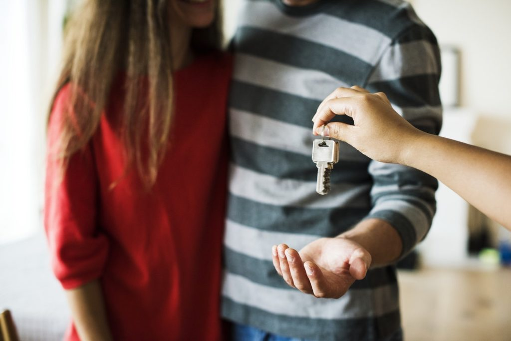 a couple receiving a house key